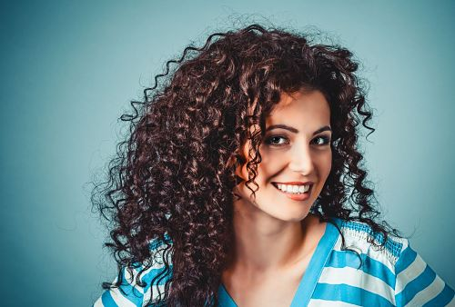 how to tame curly frizzy hair, how to stop frizzy curly hair